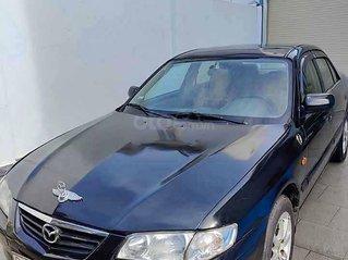 Cần bán lại xe Mazda 626 đời 2001, màu đen còn mới