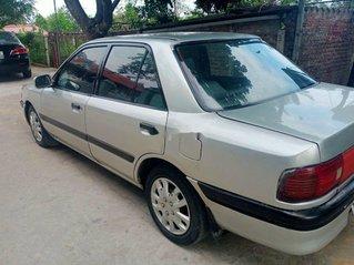 Xe Mazda 323 sản xuất 1995, màu xám, xe nhập còn mới