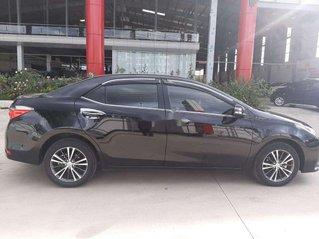 Cần bán lại xe Toyota Corolla Altis đời 2018, màu đen còn mới
