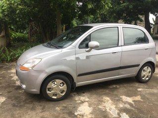 Gia đình bán ô tô Chevrolet Spark 2013, màu bạc
