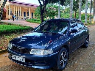 Cần bán Mitsubishi Lancer đời 2002, màu xanh lam, số sàn