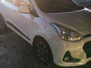 Bán xe Hyundai Grand i10 sản xuất 2019, màu trắng còn mới, 318 triệu