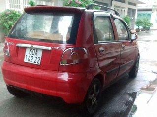 Cần bán xe Daewoo Matiz đời 2006, màu đỏ còn mới