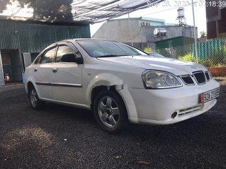 Cần bán gấp Daewoo Lacetti sx 2004, màu trắng còn mới