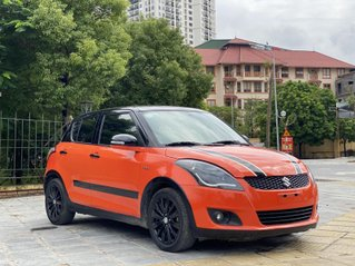 Cần bán xe Suzuki Swift SX 2015, màu cam nội thất đen, đi 52 000km