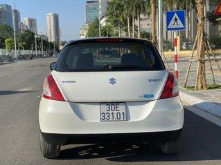 Cần bán xe Suzuki Swift SX 2016, màu trắng, đi 58000km