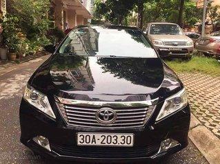 Bán Toyota Camry năm 2014, màu đen, chính chủ, 665 triệu