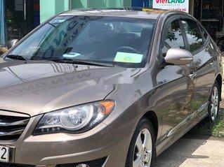 Cần bán lại xe Hyundai Avante đời 2011, màu ghi vàng