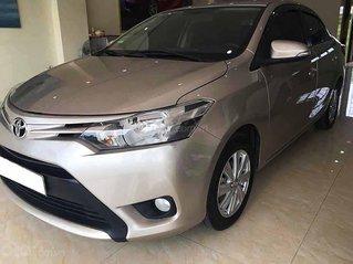 Bán lại xe Toyota Vios 1.5E sản xuất 2015, màu bạc, số sàn