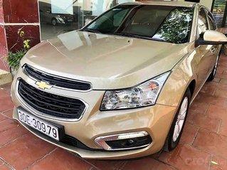 Bán Chevrolet Cruze 1.6 MT năm 2015 màu vàng cát, giá tốt