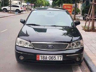 Cần bán xe Ford Laser Ghia 1.8 MT sản xuất năm 2003, màu đen, giá cạnh tranh