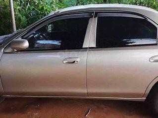 Cần bán lại xe Mazda 323 đời 2000, màu ghi vàng