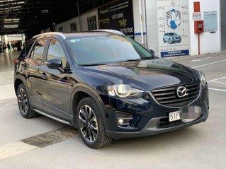 Bán Mazda CX 5 đời 2016, số tự động, màu xanh đen