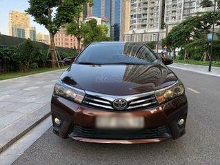 Cần bán xe Toyota Corolla Altis đời 2015, màu nâu