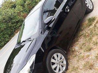 Cần bán xe Toyota Vios năm 2015, màu đen còn mới