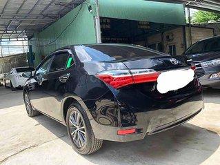 Cần bán xe Toyota Corolla Altis sản xuất 2019, màu đen còn mới giá cạnh tranh