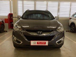 Cần bán xe Hyundai Tucson AT 2011, màu xám, gia đình TP. HCM, đi 60.000km - xe cũ chính hãng Toyota Sure
