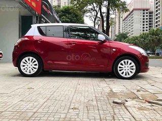 Cần bán gấp Suzuki Swift 1.4 AT đời 2013, màu đỏ, xe nhập chính chủ, 355 triệu