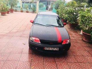 Bán Ford Laser Deluxe sản xuất năm 2001, màu đen xe gia đình, giá chỉ 139 triệu