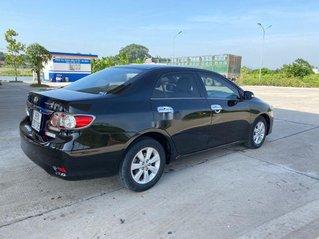 Cần bán lại xe Toyota Corolla Altis năm sản xuất 2013, màu đen, số sàn