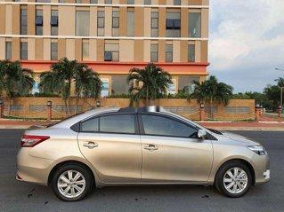 Gia đình bán xe Toyota Vios 2016, màu vàng cát