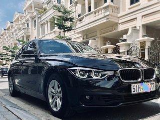 Cần bán xe BMW 320i LCi đời 2016, màu đen