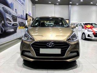 Cần bán Hyundai Grand i10 đời 2020, màu vàng cát