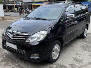 Bán xe Toyota Innova V 2010, màu đen, giá 330 triệu, đã đi 125.000 km, biển số TP. HCM