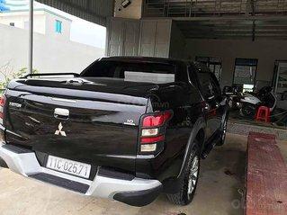 Cần bán xe Mitsubishi Triton năm 2015, màu đen, xe nhập còn mới