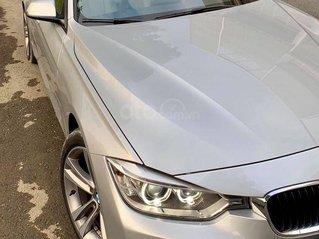Bán BMW 320i 2013, model 2014, màu bạc