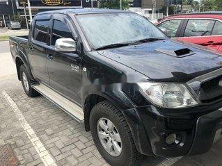 Bán Toyota Hilux năm sản xuất 2009, màu đen như mới