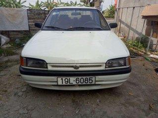 Cần bán gấp Mazda 323 sản xuất 1995, màu trắng