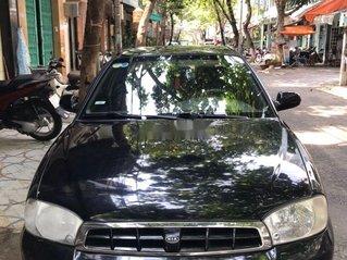 Cần bán Kia Spectra năm sản xuất 2004, màu đen, giá 100tr