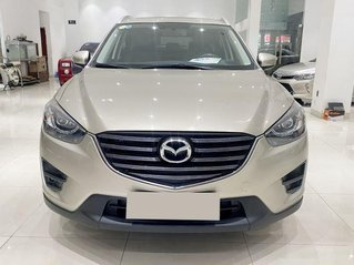 Cần bán Mazda CX 5 sản xuất 2016, màu vàng, giá 675tr