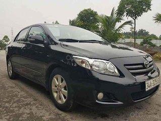 Cần bán lại xe Toyota Corolla Altis năm 2010, màu đen, số sàn