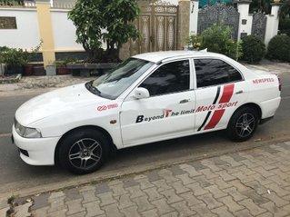 Gia đình bán Mitsubishi Lancer đời 2001, màu trắng
