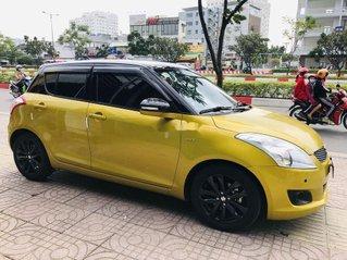 Cần bán xe Suzuki Swift 2017, màu vàng số tự động