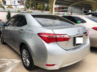 Cần bán lại xe Toyota Corolla Altis sản xuất năm 2015, màu trắng còn mới, 550tr