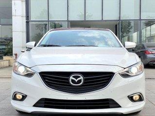 Bán ô tô Mazda 6 2.0 AT sản xuất 2015, màu trắng còn mới, giá 599tr