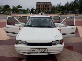 Xe Mazda 323 năm 1995, màu trắng, nhập khẩu nguyên chiếc chính chủ, giá tốt