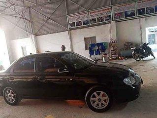 Cần bán gấp Kia Spectra 1.6 MT sản xuất năm 2004, màu đen, giá tốt