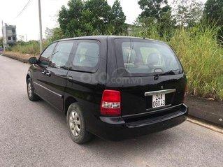 Bán xe Kia Carnival năm sản xuất 2008, màu đen số tự động
