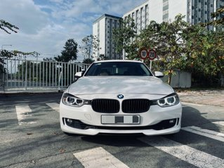 Em cần bán BMW 328i model 2013, odo 66.000km như mới