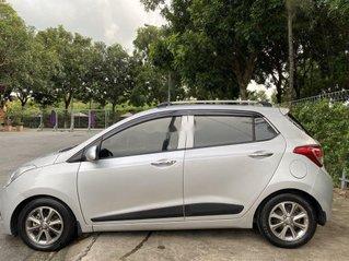 Cần bán Hyundai Grand i10 đời 2014, màu bạc, nhập khẩu nguyên chiếc