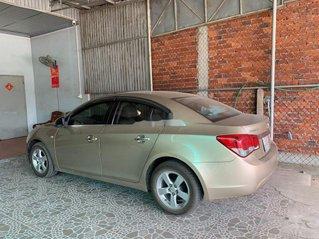 Cần bán gấp Chevrolet Cruze sản xuất năm 2011, màu vàng chính chủ