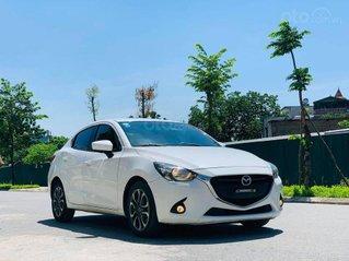 Bán Mazda 2 nhập khẩu 2015 màu trắng tinh khôi