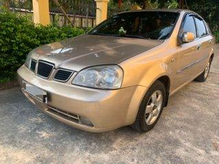 Cần bán xe Daewoo Lacetti EX 2004, màu vàng cát