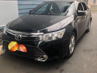 Cần bán xe Toyota Camry năm sản xuất 2015, màu đen xe gia đình, giá 819tr