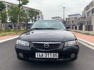 Cần bán Mazda 626 sản xuất 2000, màu đen, nhập khẩu nguyên chiếc số sàn