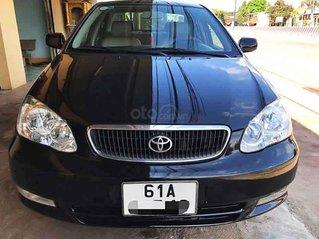 Cần bán Toyota Corolla Altis đời 2004, màu đen chính chủ, giá tốt